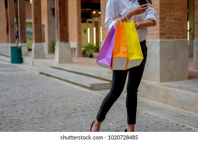 Happy woman with shopping bags enjoying in shopping.Shopping lifestyle concept