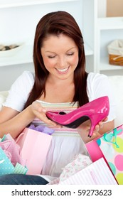 Happy woman with shopping bagsn at home