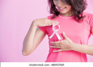 Happy Woman show pink ribbon, great for prevention breast cancer concept