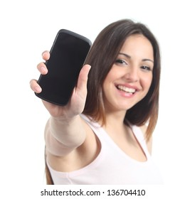 Happy woman showing a black mobile phone screen isolated on a white background