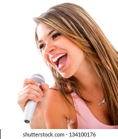 Happy woman singing with a microphone - isolated over a white background