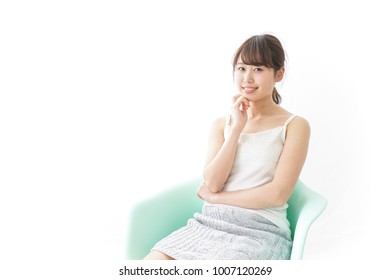 Happy woman sitting on the chair