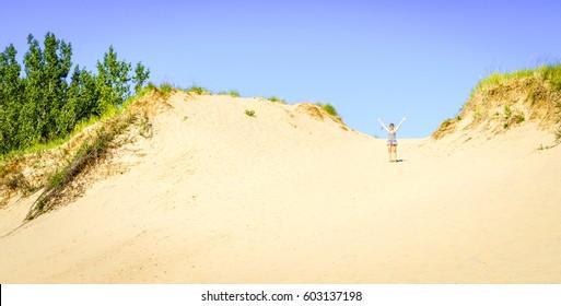 Happy woman in Sleeping Bear Dunes in Northern Michigan