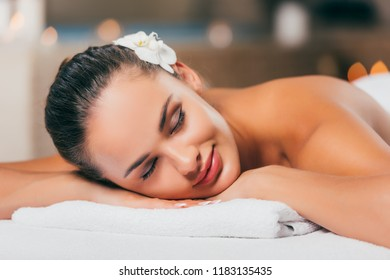 happy woman sleeping at spa salon