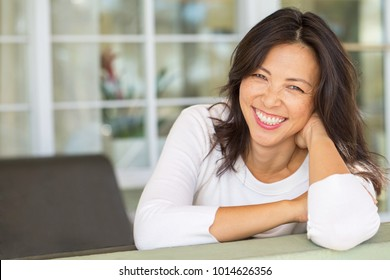 Happy woman smiling.