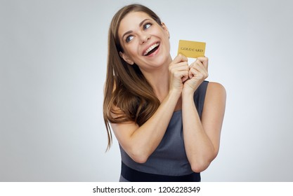 Happy woman smiling and holding credit card isolated studio portrait