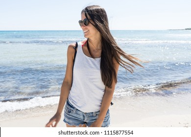 Happy woman smiling on the beach