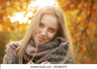 happy woman smiling in park at autumn sunset, toned image