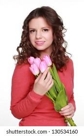 Happy woman with a spring mood and beautiful pink tulips  on white background