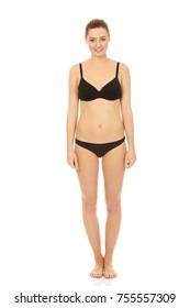 Happy woman standing in bikini.
