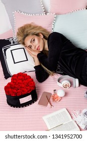 Happy woman or teenage girl with headphones listening to music from smartphone - Image.Beautiful girl in pajama lying in bed in bedroom