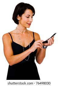 Happy woman text messaging on a mobile phone isolated over white