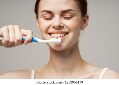 Happy woman With a toothbrush in hand
