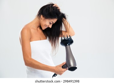 Happy woman in towel drying her hair isolated on a white background