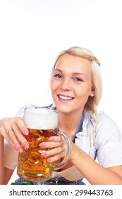 Happy woman in traditional costume is drinking beer isolated
