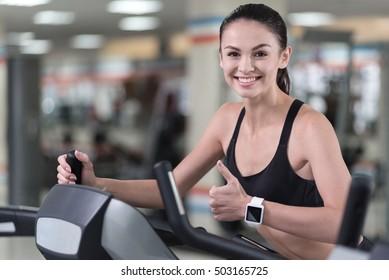 Happy woman training in a gym
