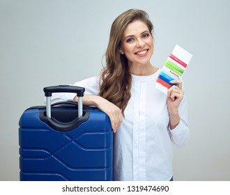 happy woman travel holding document for good trip. isolated studio portrait.