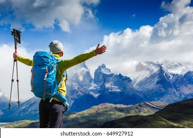 Happy Woman Traveler with Backpack hiking in the Mountains. mountaineering sport lifestyle concept