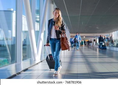 Happy woman traveling and walking in airport