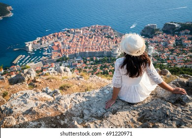 Happy woman travels in Croatia - Panoramic view of Dubrovnik, Dalmatia, Croatia hike. Dubrovnik Old Town is the world famous destination to travel in Croatia. Center of activity and luxury traveling.