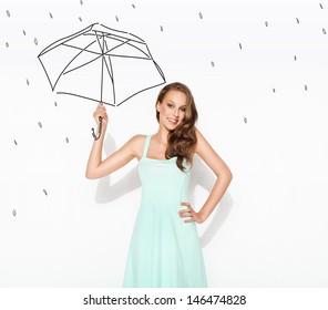 Happy woman under drawn rain and drawn umbrella