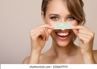 Happy woman using nose applicator mask.