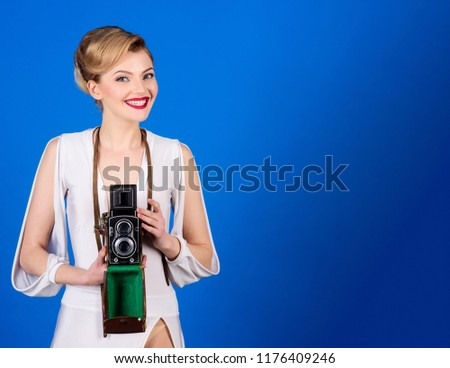 340b202d94b9a Happy woman with vintage photo camera. Fashion girl holds retro  photocamera. Photography