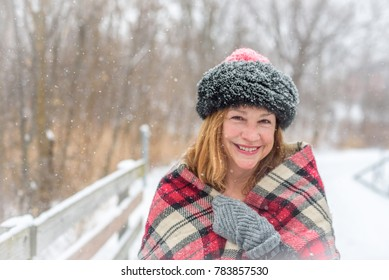 happy woman walking outside in beautiful light snowfall
