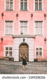 Happy woman walking in Stockholm travel sightseeing architecture landmarks lifestyle summer vacations tour in Sweden