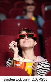 Happy woman is watching 3D movie