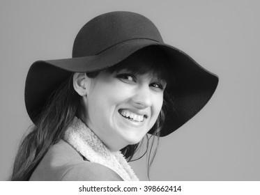 Happy woman wearing a hat