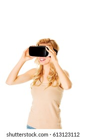 Happy woman wearing virtual reality goggles