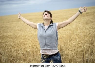 happy woman in wheat field