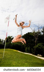 happy  woman who plays golf with high heels