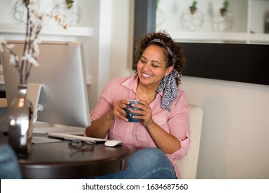 Happy woman working from her home office.