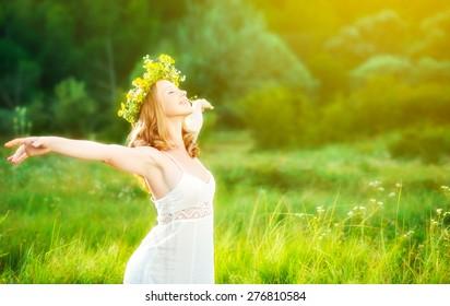 happy woman in wreath outdoors summer enjoying life opening hands