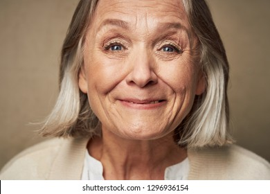 Happy woman with wrinkles on her face