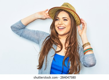 Happy woman  with yellow hat. Studio portrait. Female model with long hair. Beautiful girl.