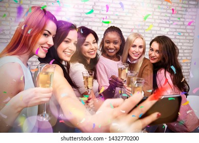 Happy Women With Champagne And Smartphone Taking Selfie At Night Club