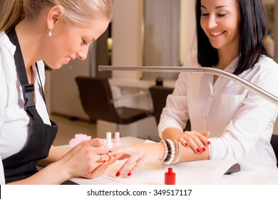 Happy women doing manicure