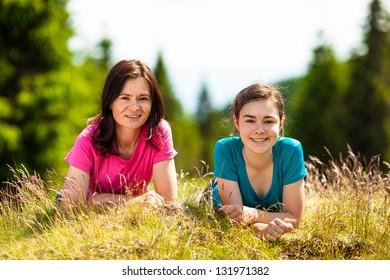 Happy women lying outdoor