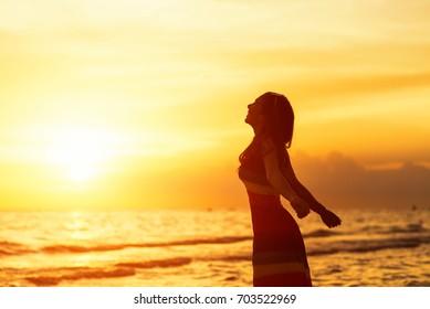 Happy women on the beach