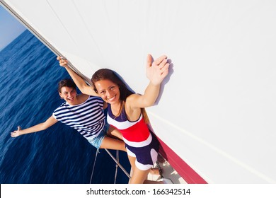 Happy women on the bow of a Sail Boat.Copy space