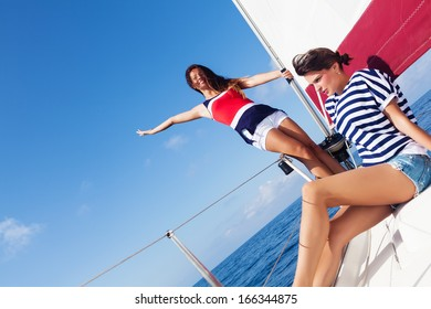 Happy women on the bow of a Sailboat.Copy space