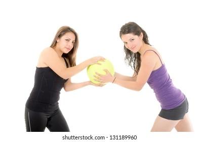 Happy women pulling a ball