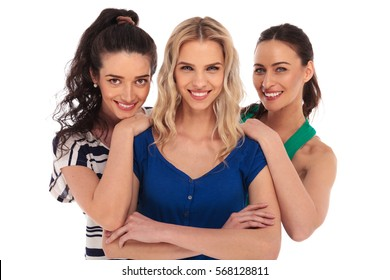 happy women standing together and smile on white background in studio