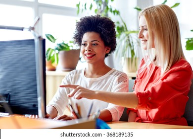 happy women or students with computer in office