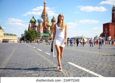 Happy women walking in white dress at the red square in Moscow