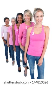 Happy women wearing pink and ribbons for breast cancer on white background