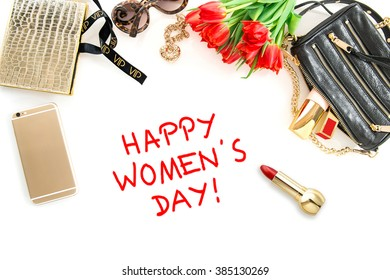 Happy Womens Day! Fashion mock up with accessories, flowers, cosmetics, bag and jewelry.